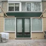 Deze uitbouw met groene deur is ook door ons gerealiseerd